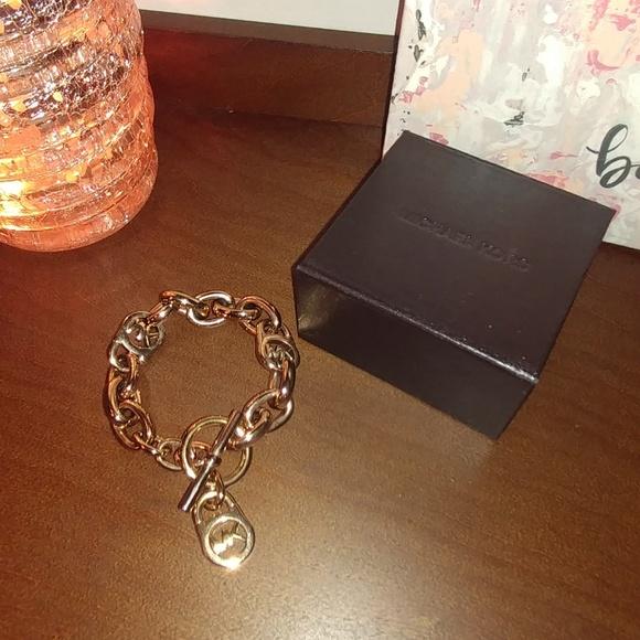 a98936119c7cf Michael Kors Heritage Rose Gold Logo Lock Bracelet.  M 5b610df93c9844d1ba42e847